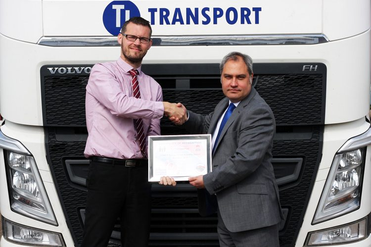 AWARD: TJ's transport director, Neil Glazebrook, left, receives the accolade from Mark Fennell, CEMEX's commercial haulage capacity manager for the South. Haulage specialst TJ won the national award for leading the way with a cycle safe campaign.