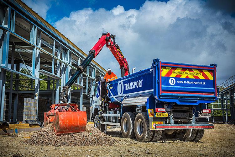 TJ Transport grab lorry grabbing gravel and building materials
