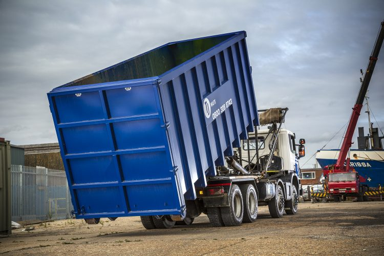 Commercial waste container on truck