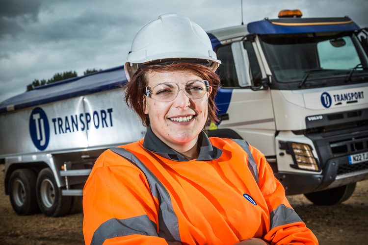 TJ Transport driver in front of tipper lorry