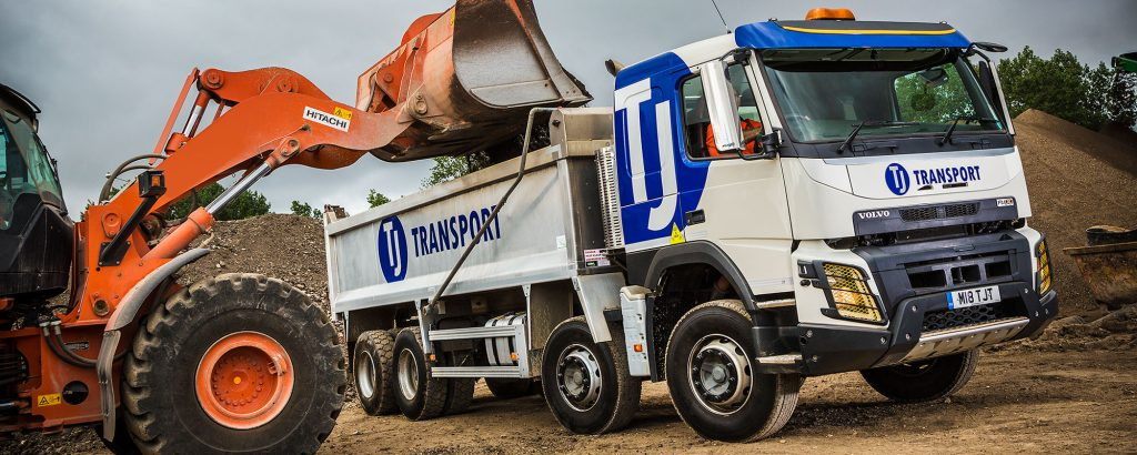 TJ Transport tipper lorry being loaded with aggregates