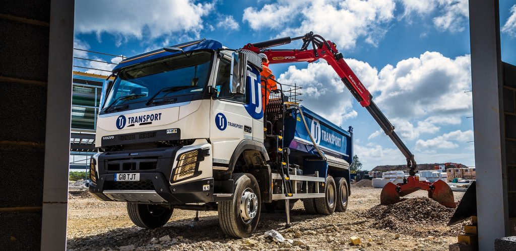 Grab lorry collecting gravel for driveways