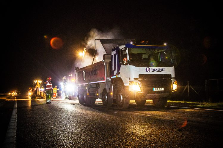 Tipper truck nighttime road haulage